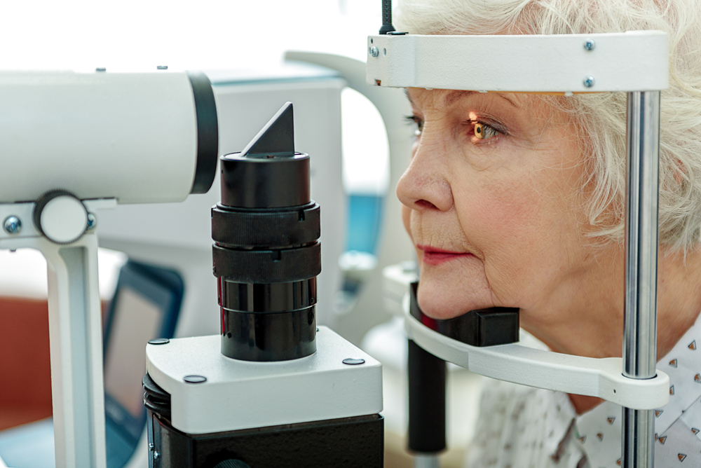 Elderly woman getting a glaucoma screening.